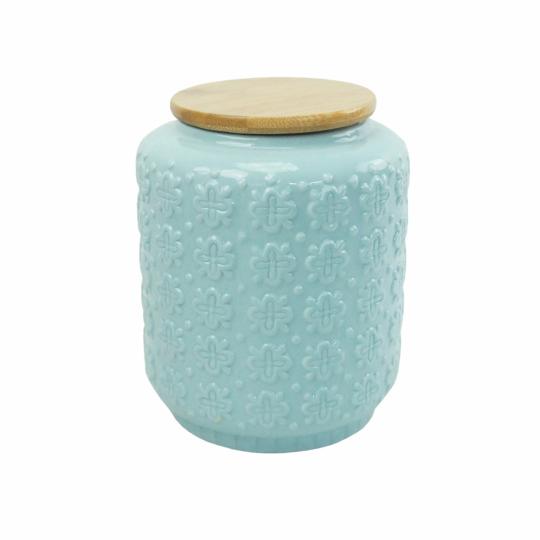 pote de cerâmica azul com tampa de madeira